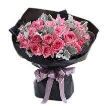 two dozen pink roses in a beautiful bouquet