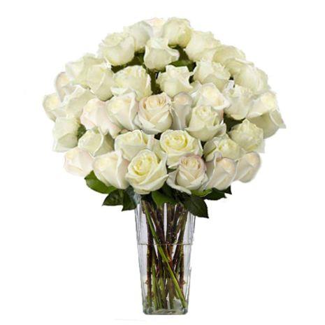 two dozen white roses in glass vase to vietnam